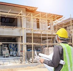 Home Inspector Monitoring New Construction Site